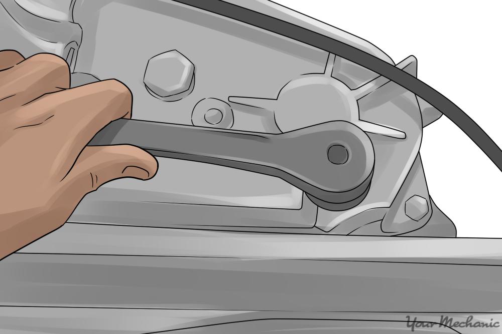 mechanic removing fluid level inspection plug on transfer case