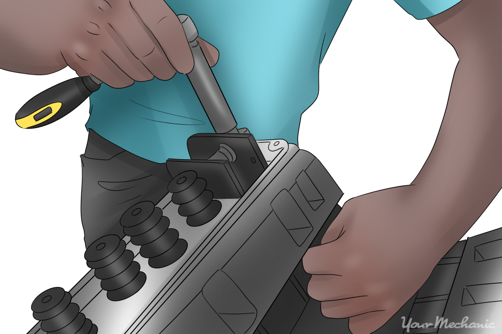 person disassembling the valve train