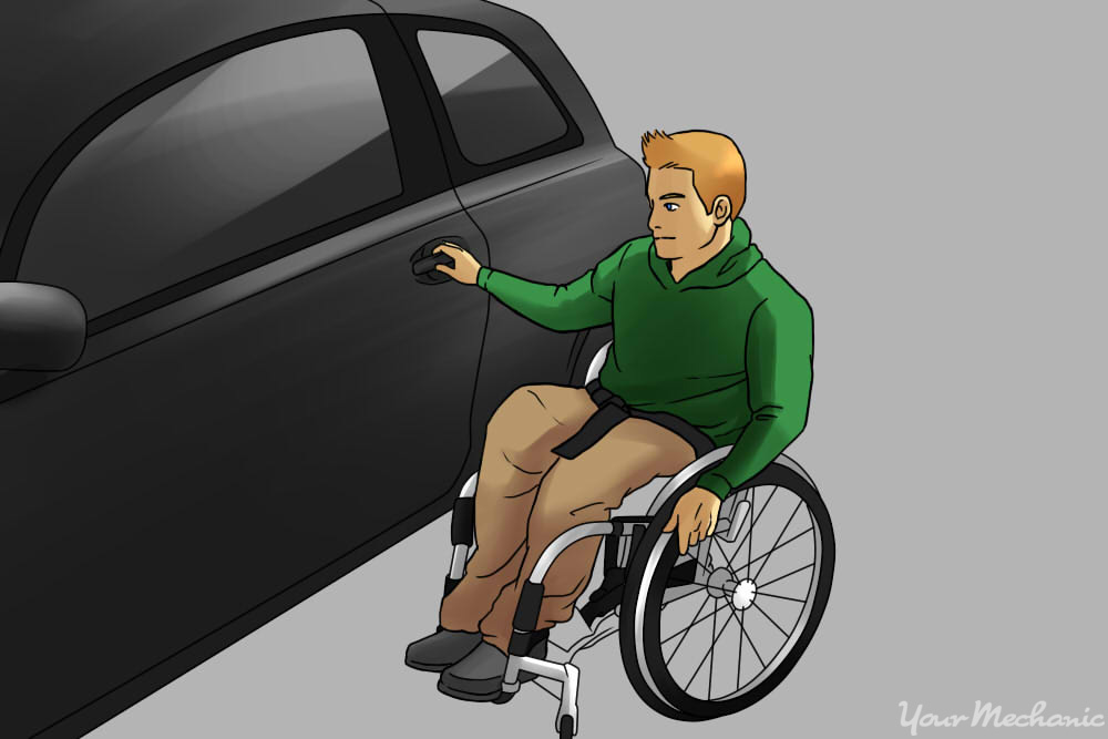 man in wheelchair getting into a car