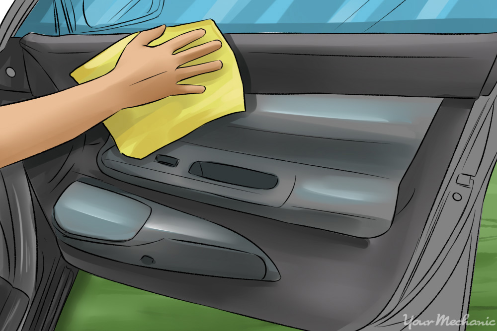 wiping car door with a microfiber cloth