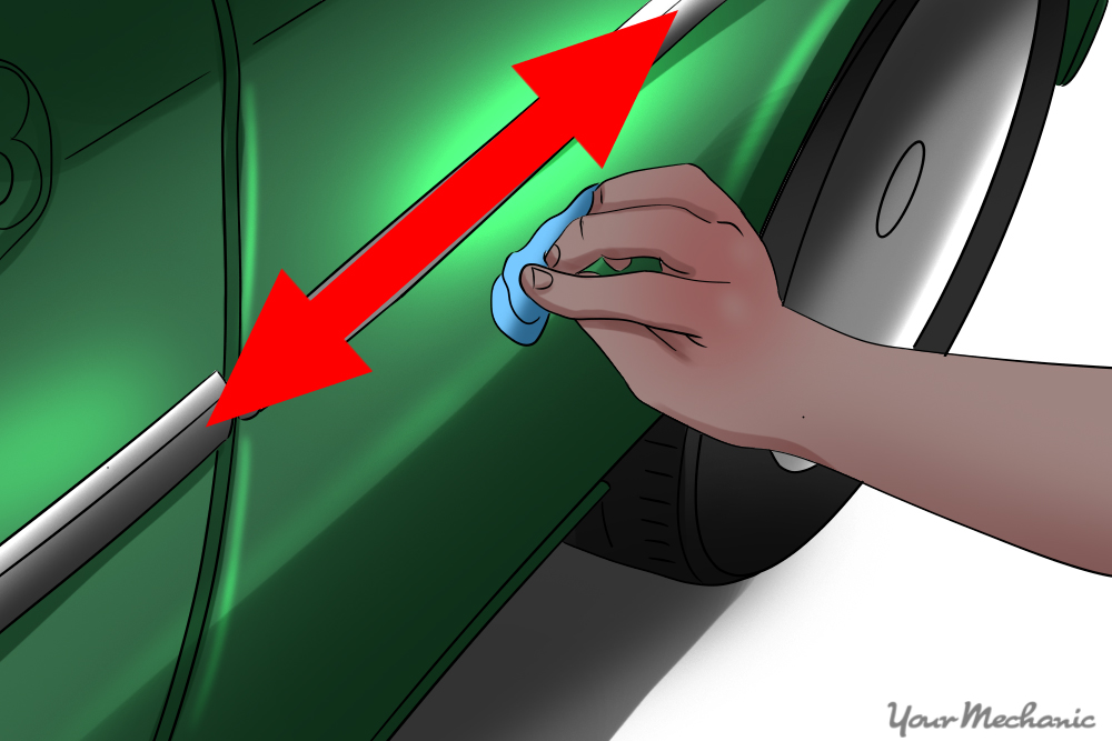 person rubbing bar on side of car