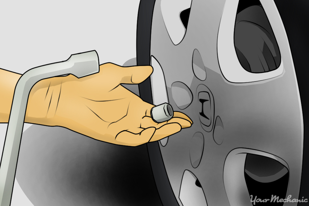 person removing lug nuts from wheels
