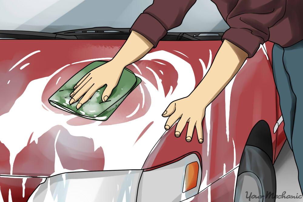 person scrubbing with a microfiber towel