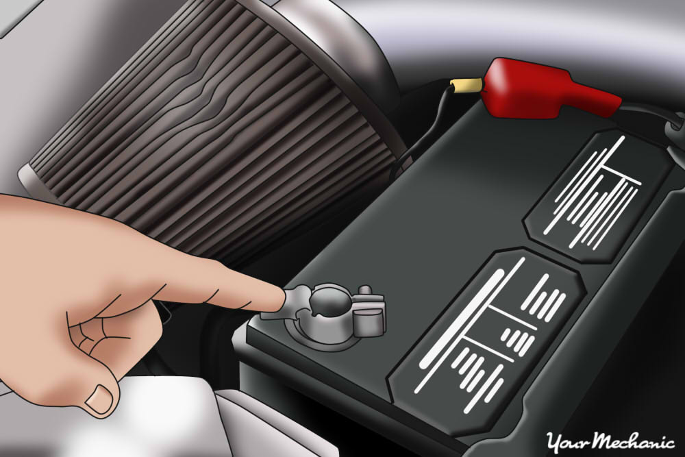 Person Pointing At Black Terminal Of Car Battery