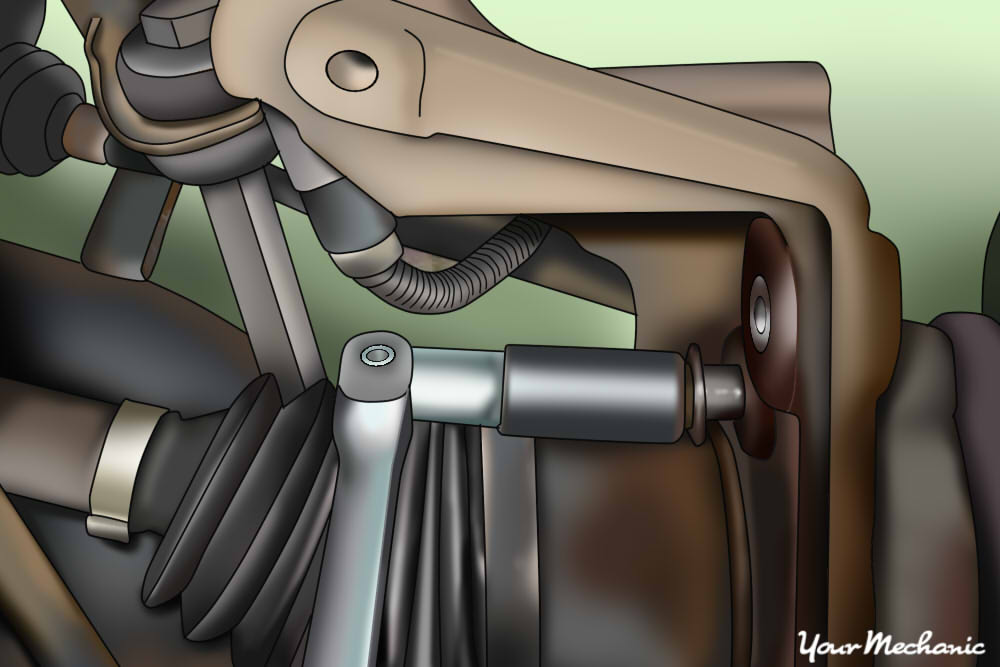 person removing caliper bolts with ratchet socket