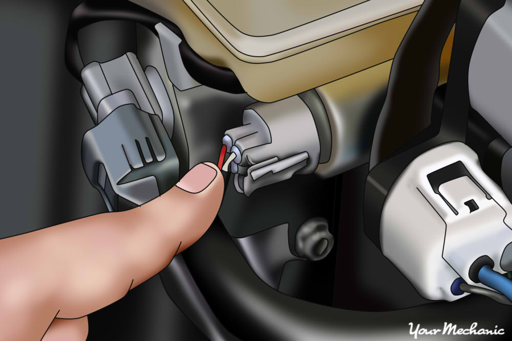 picture of mechanic pointing to anti-lock brake pressure switch mounted to master cylinder