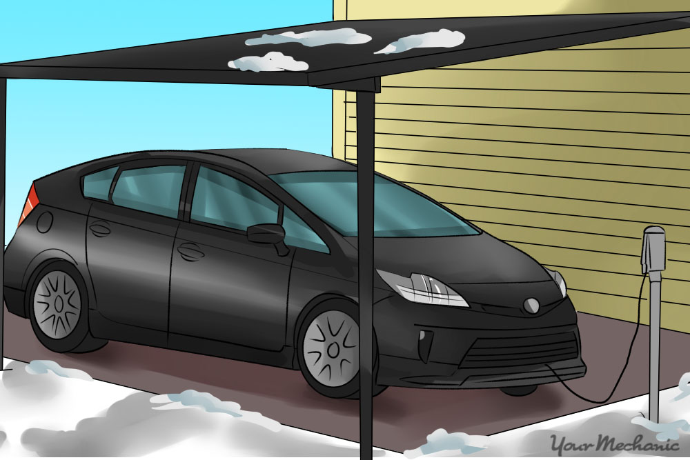 car parked under a carport with a battery heater plugged in
