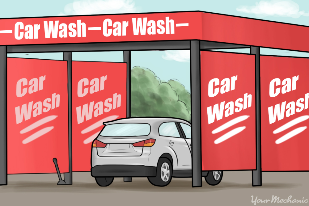 car parked inside self service car wash bay