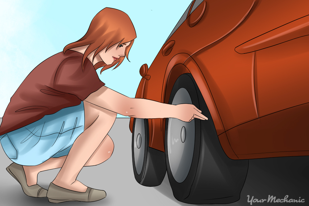 woman inspecting tire with no tools
