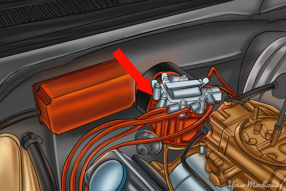 green arrow pointing to a distributor inside an open engine