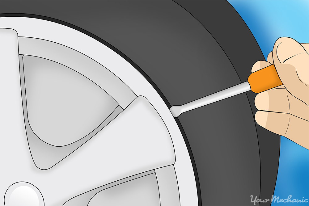 person removing hubcap