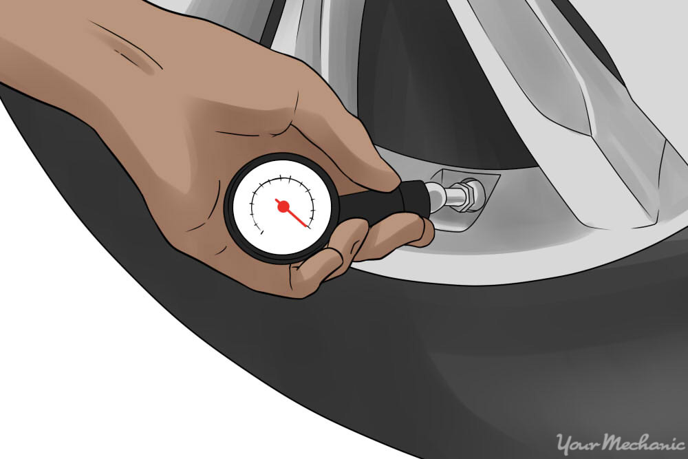 person using a pressure gage on the tire