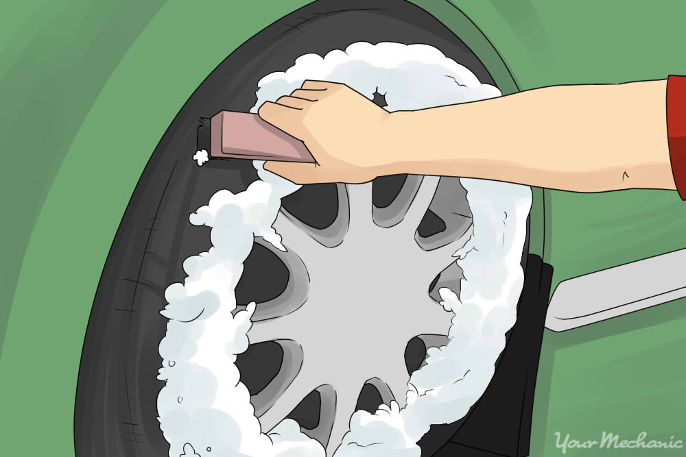 spraying foam on carwheel