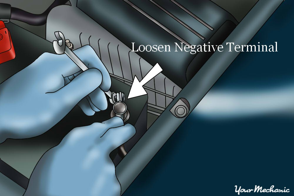 person removing negative battery terminal