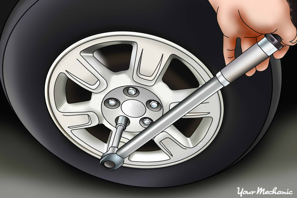 using lug wrench to remove tire
