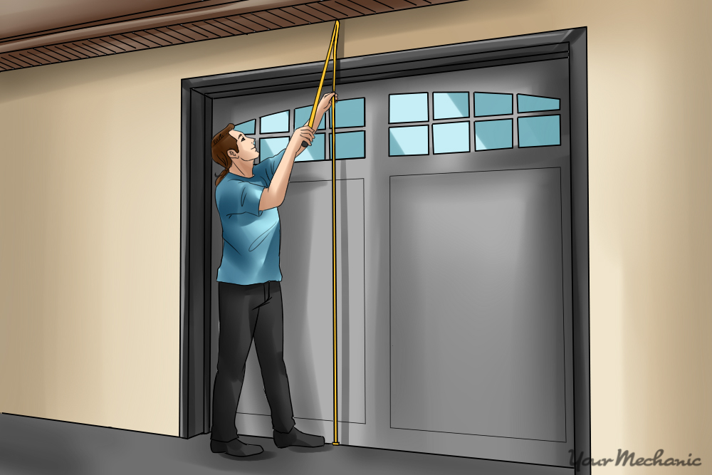 person measuring garage ceiling height