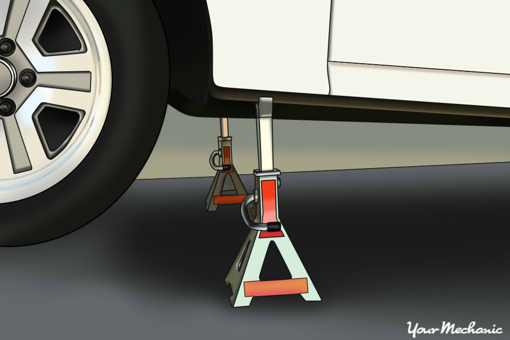 placing jack stands under vehicle