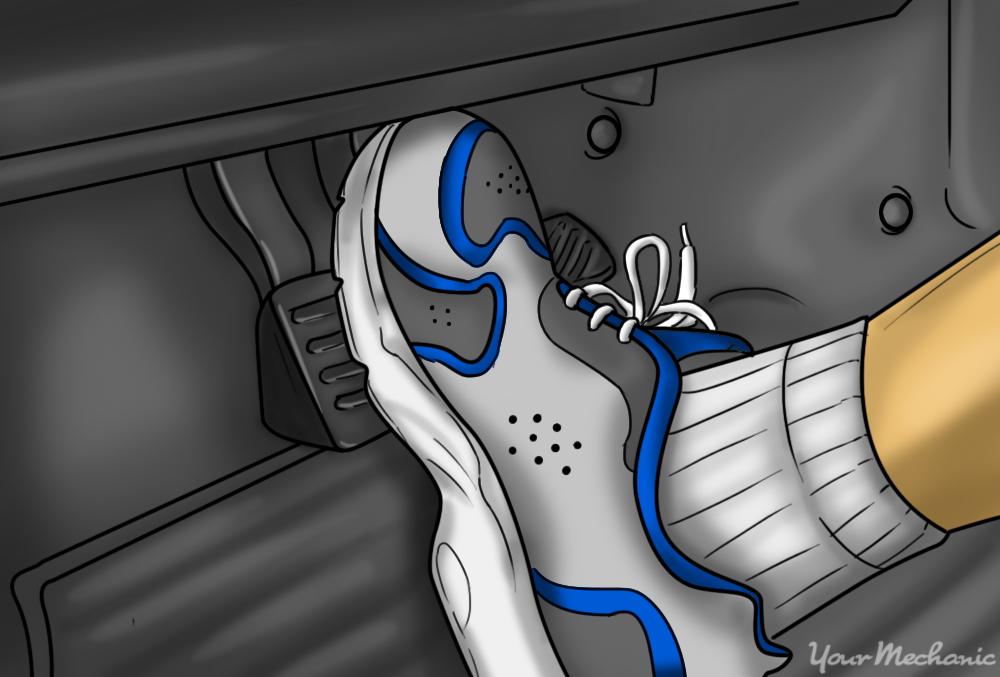 foot pressing down brake pedal