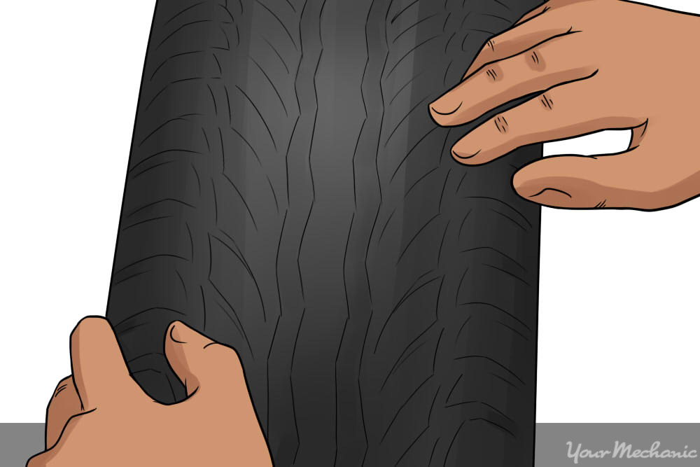 close up of person inspecting tire