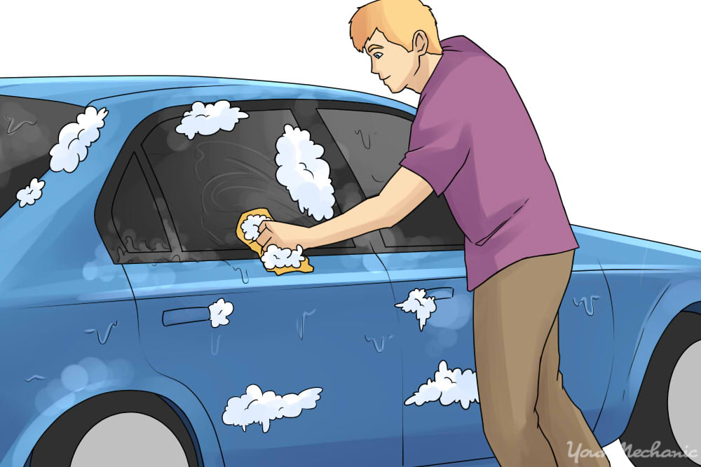 person cleaning car