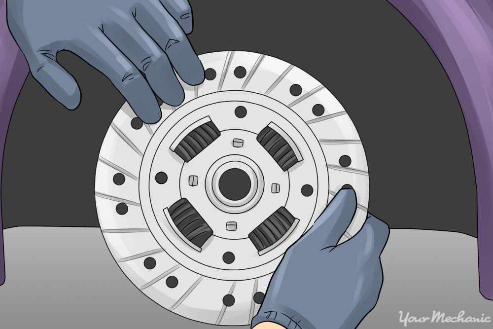 person replacing clutch disc