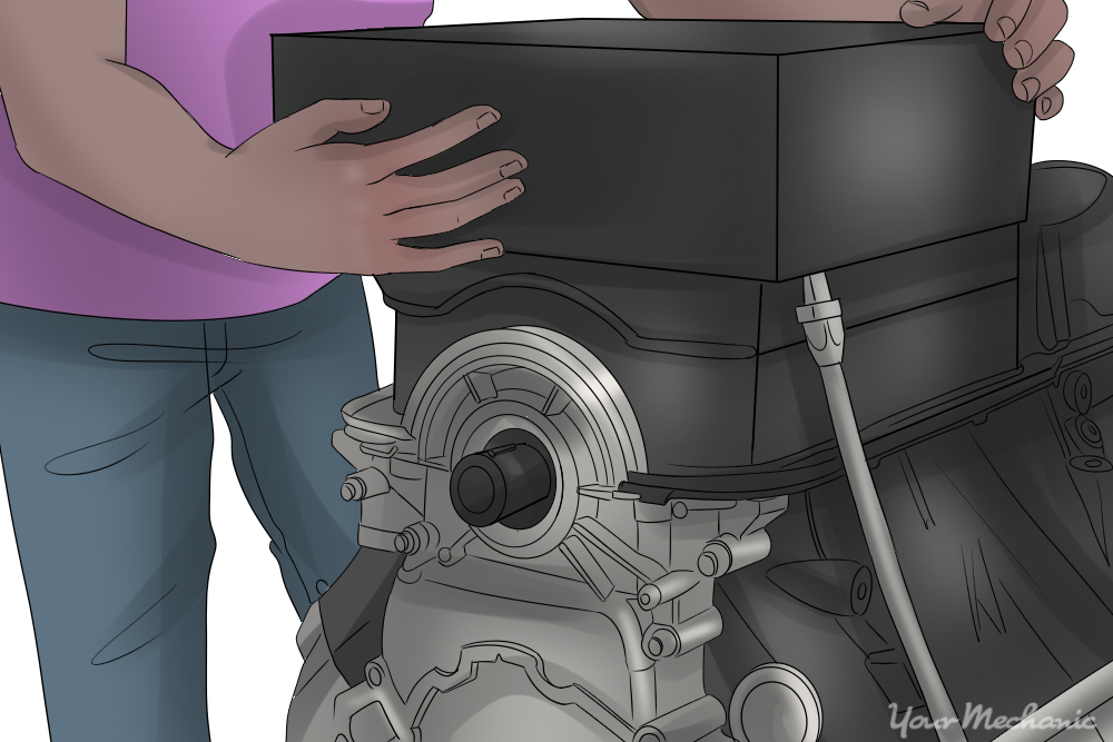 person installing oil pan