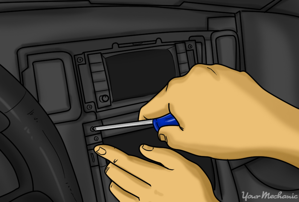 person removing screws that secure oem head unit