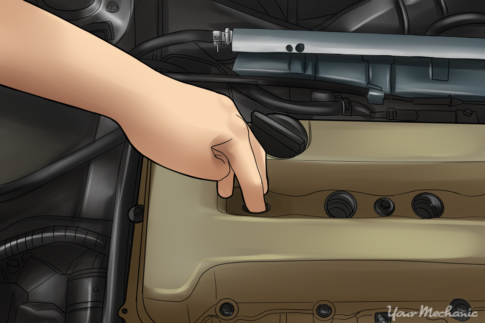 how to find top dead center yourmechanic advicehand putting finger on spark plug hole