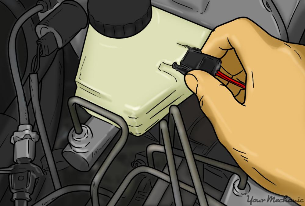 hand unplugging the fluid sensor