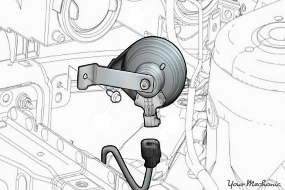 diagram showing how to remove the electrical connector from the horn