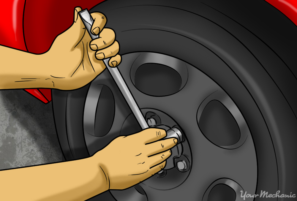 person tightening lug nuts