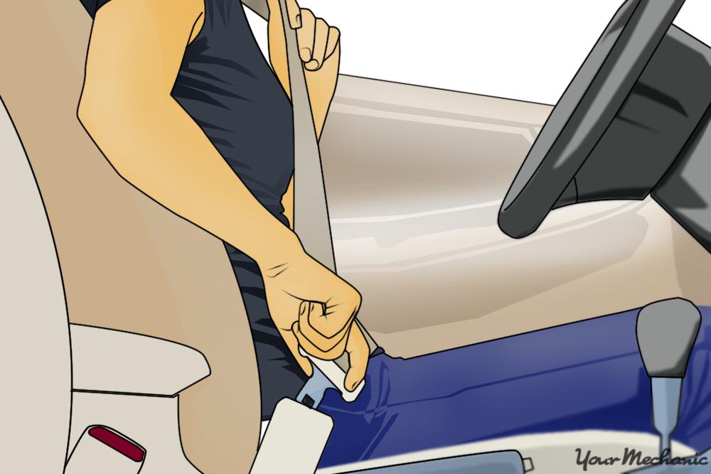 woman pulling seat belt across her body