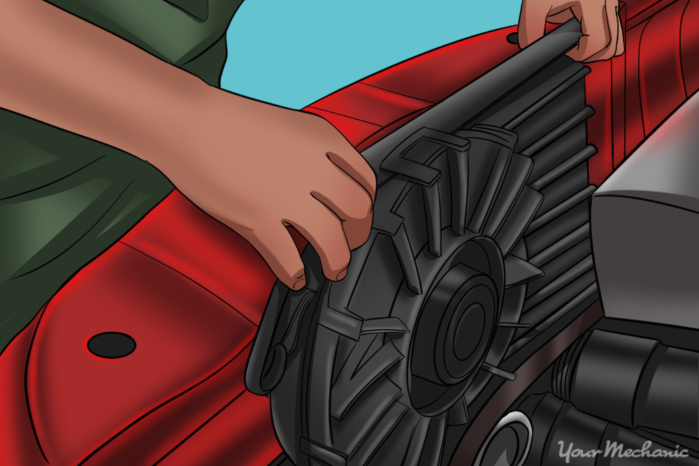 mechanic removing cooling fan assembly from vehicle