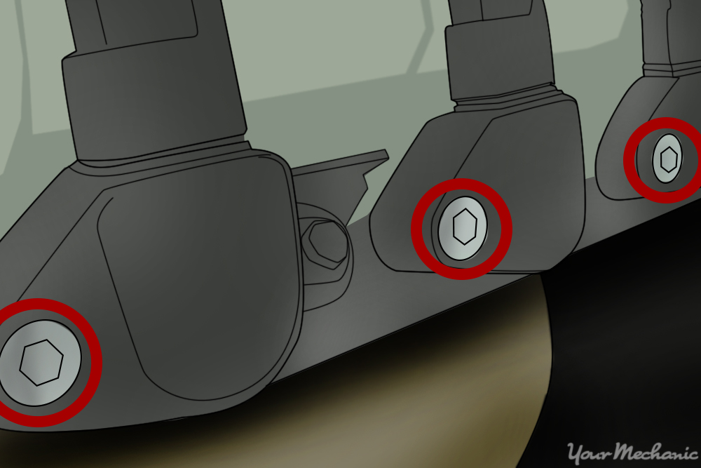 retaining bolts or screws holding the ignition coil in place as well as electrical connectors