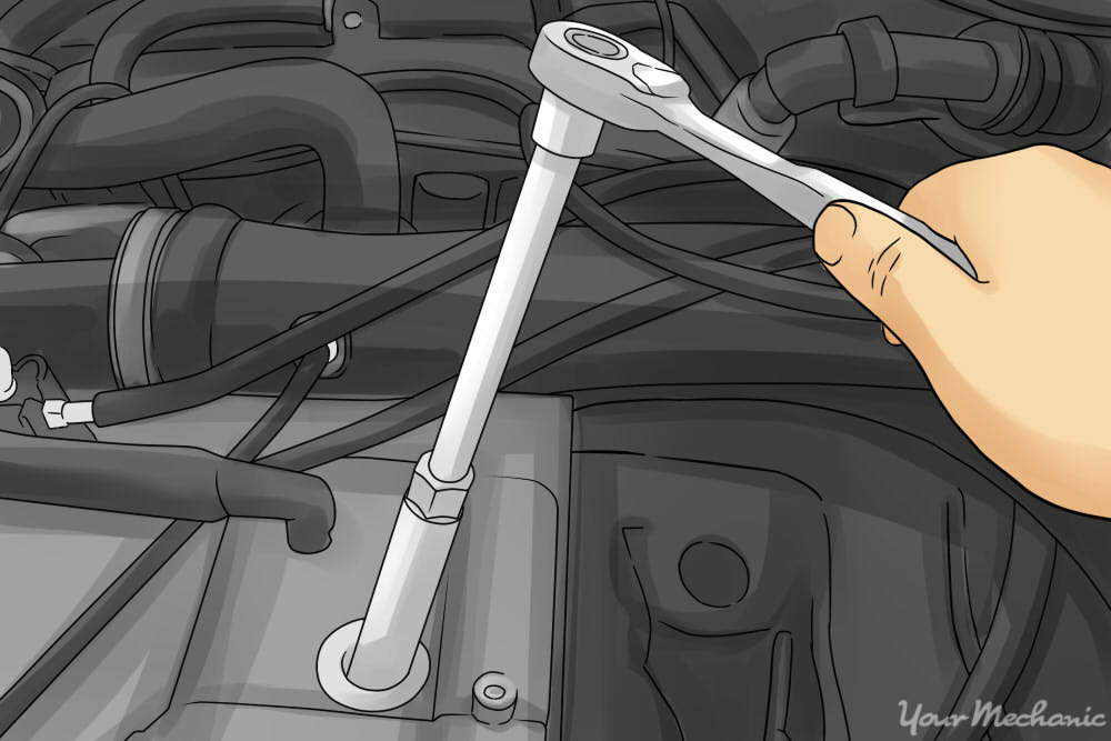 person removing the spark plugs