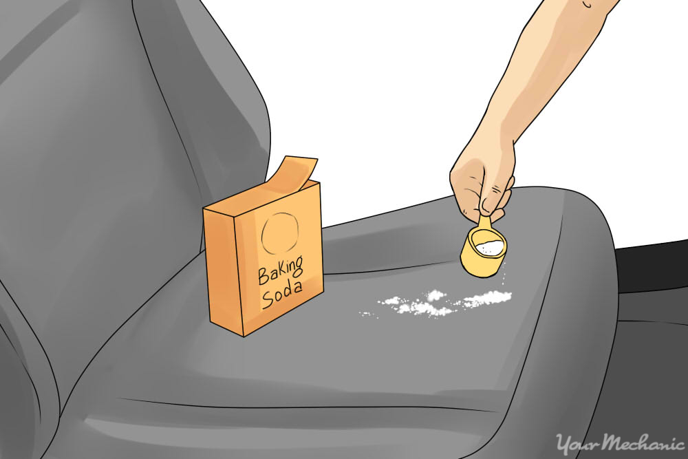 person pouring baking soda onto seat
