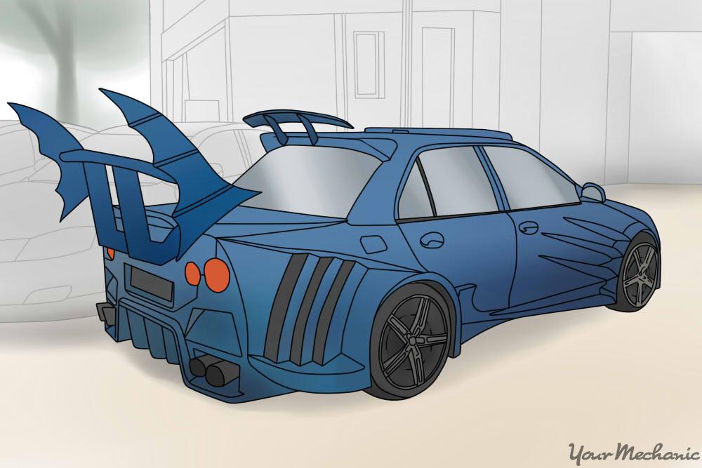 blue car with massive fin spoiler