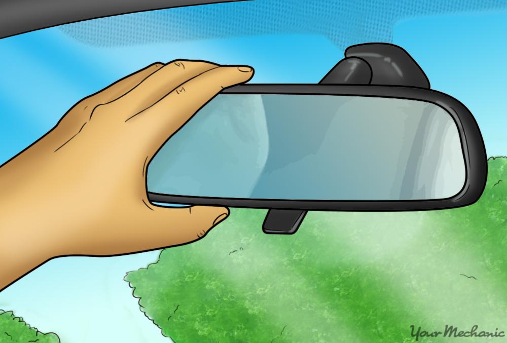 hand adjusting rearview mirror