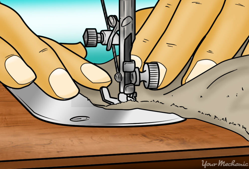 man sewing fabric together with sewing machine
