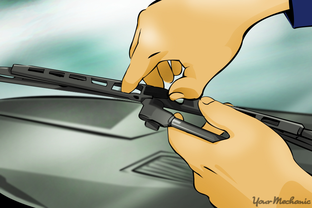 hands removing wiper blade from wiper arm