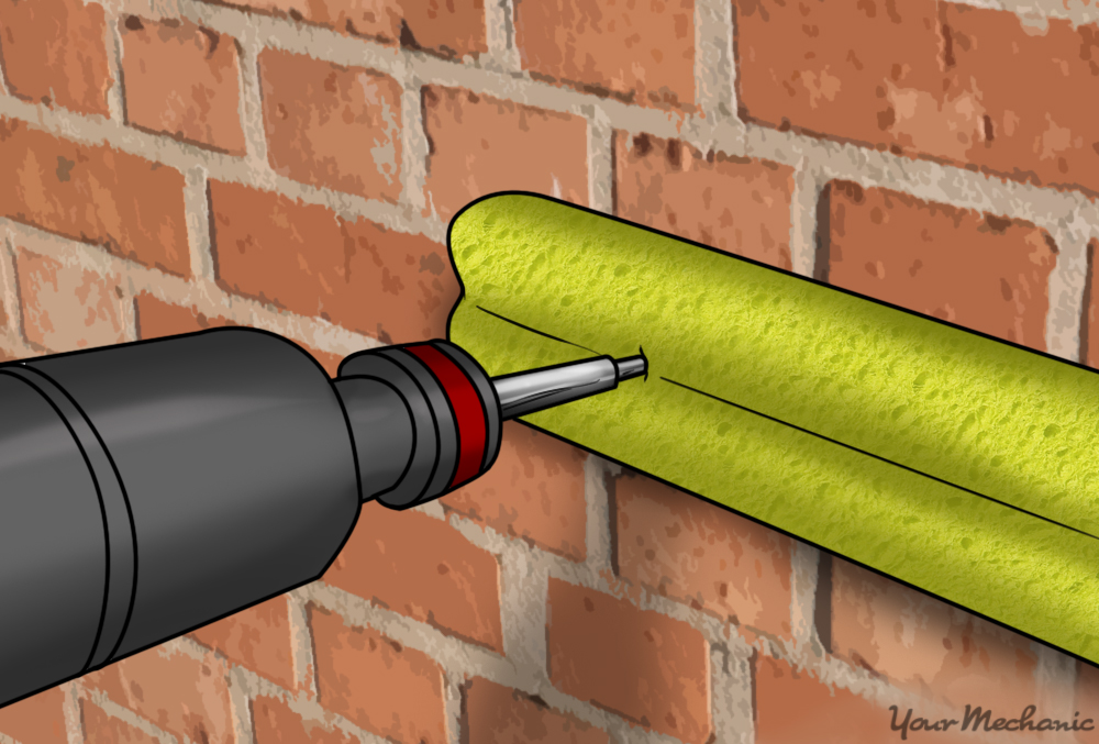 screwdriver screwing noodle onto wall