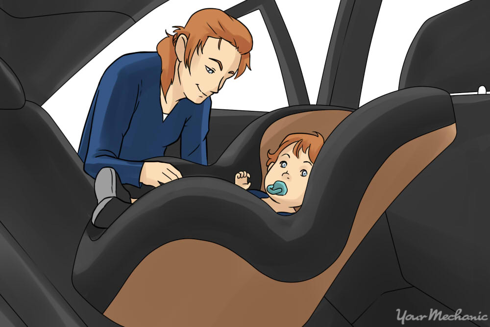 child being strapped into car seat