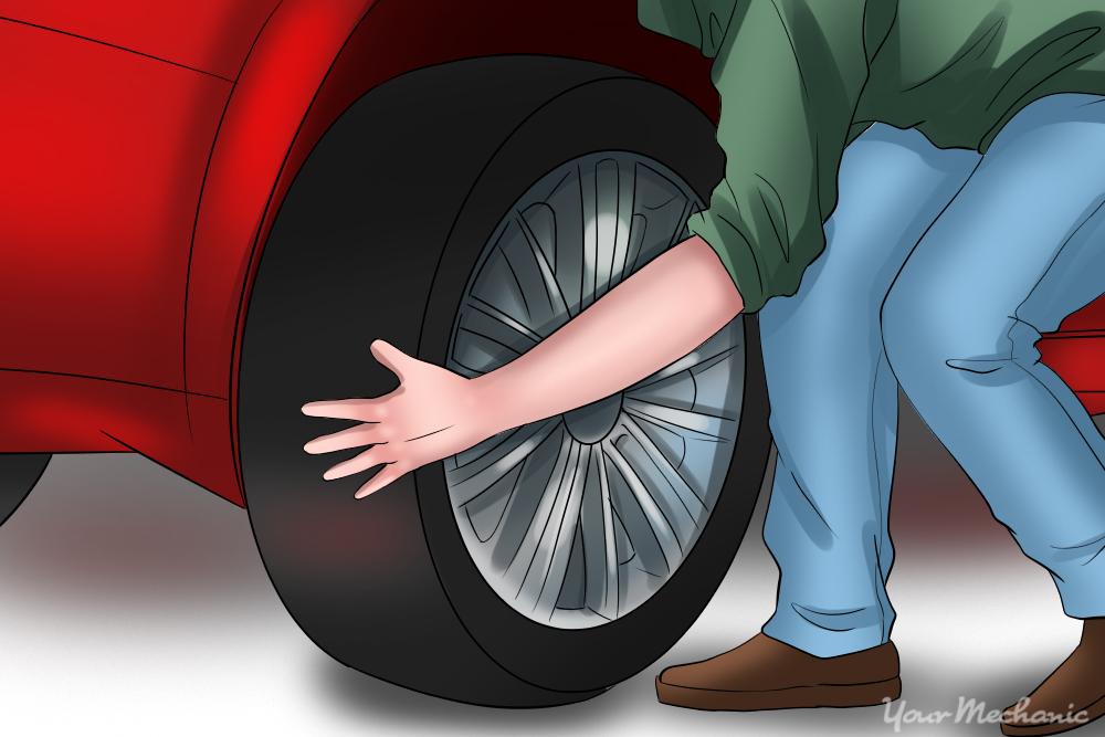 person grabbing tire