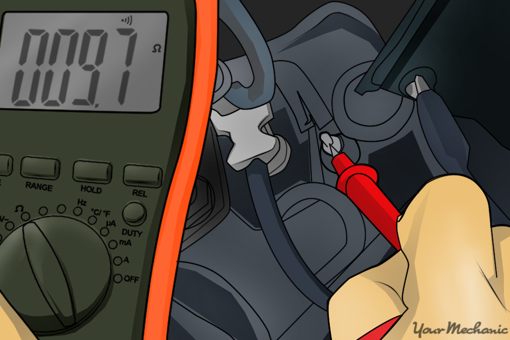 person touching positive lead of multimeter to terminal