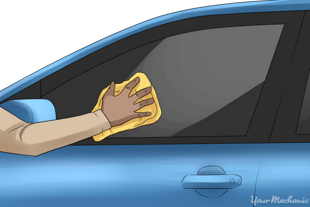 person cleaning your car windows