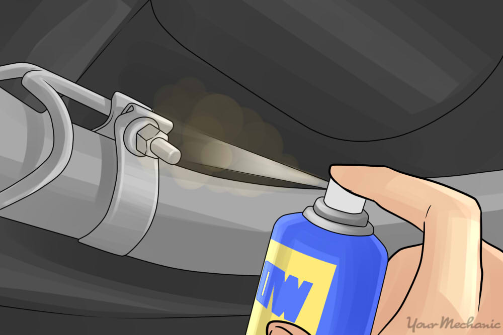 wd-40 being sprayed on an exhaust clamp
