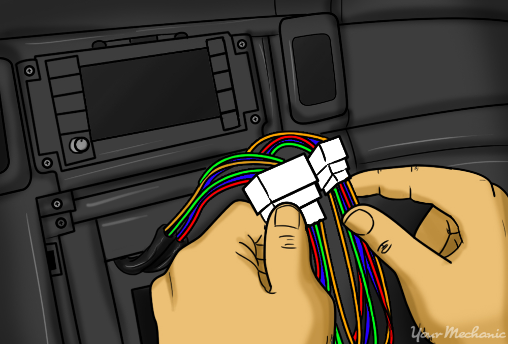 person connecting the original stereo connectors from the car to the ends of new spliced wiring harness