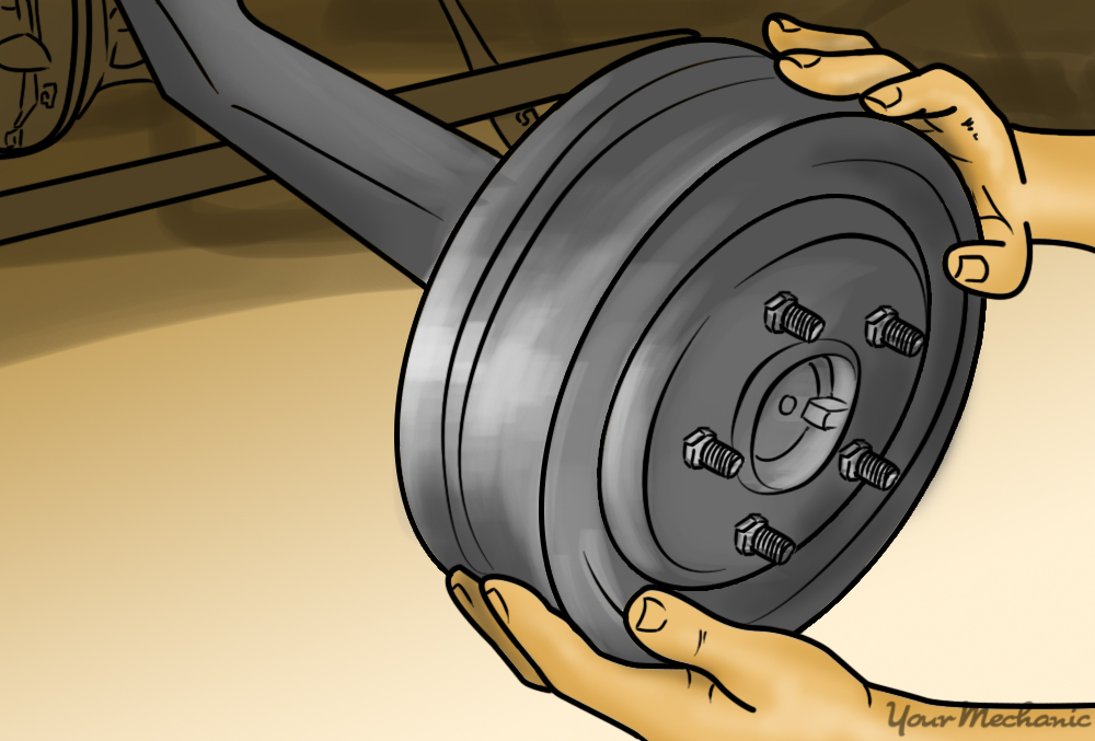 person rotating the brake drum