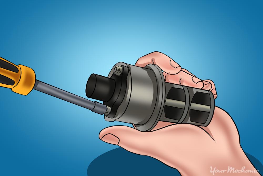 hand removing the screws attaching the EVP position sensor