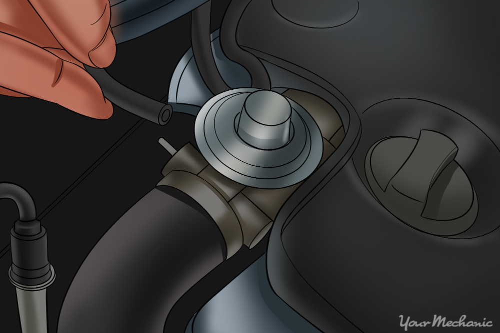 hand removing vacuum hose from EGR valve